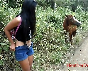 HD urinating next to horse in jungle