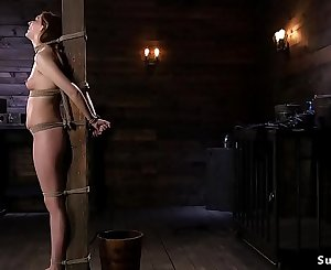 Hairy brunette slave gets stick on high-heeled shoes